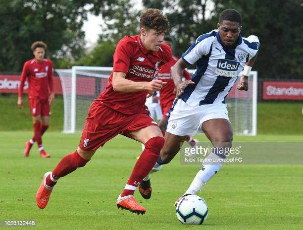 Neco Williams of Liverpool and Tyrese Dyce of West Bromwich Albion in action during the Liverpool U18 v West Bromwich Albion U18 game at The Kirkby...