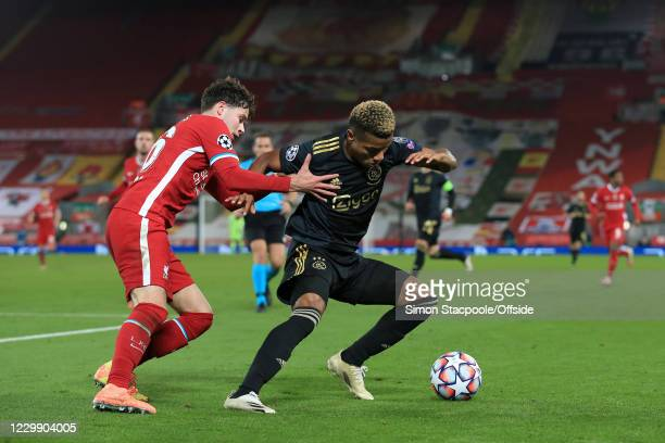 Neco Williams of Liverpool battles with David Neres of Ajax during the UEFA Champions League Group D stage match between Liverpool FC and Ajax...