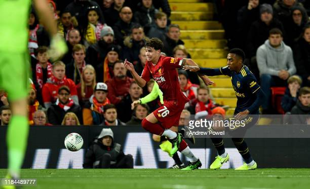 Neco Williams of Liverpool competes with Joe Willock of Arsenal during the Carabao Cup Round of 16 match between Liverpool FC and Arsenal FC at...