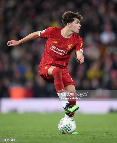 Neco Williams of Liverpool controls the ball while on his debut during the Carabao Cup Round of 16 match between Liverpool and Arsenal at Anfield on...