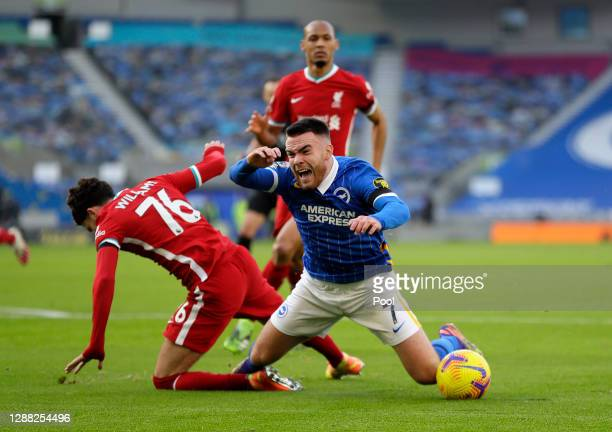 Neco Williams of Liverpool fouls Aaron Connolly of Brighton and Hove Albion to concede a penalty during the Premier League match between Brighton &...