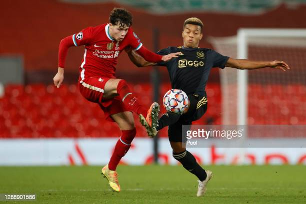 Neco Williams of Liverpool is challenged by David Neres of Ajax during the UEFA Champions League Group D stage match between Liverpool FC and Ajax...