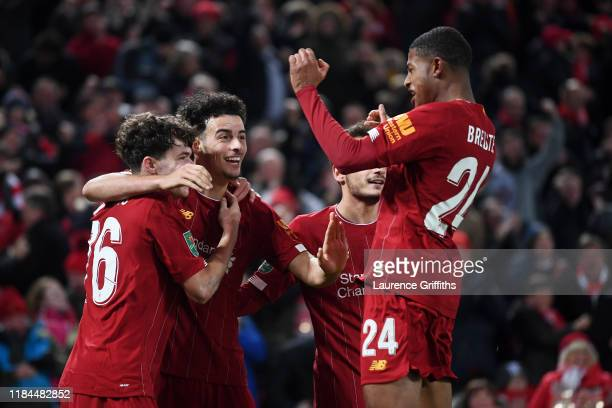 Neco Williams of Liverpool is congratulated by Curtis Jones and Rhian Brewster after assisting Liverpool's fifth goal of the game by during the...