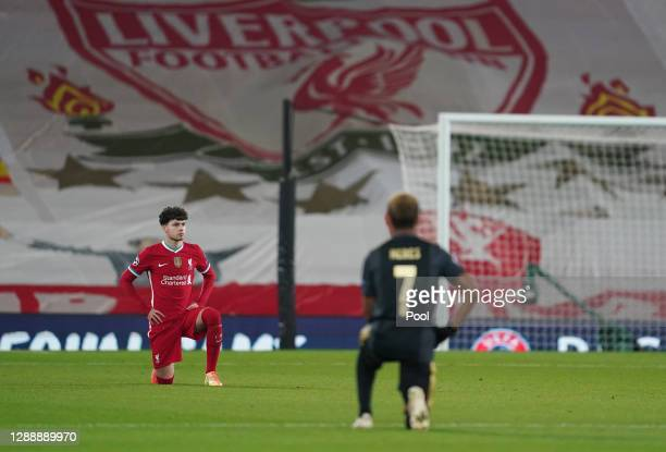 Neco Williams of Liverpool takes a knee in support of the Black Lives Matter Movement prior to the UEFA Champions League Group D stage match between...