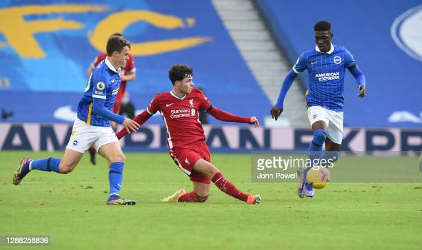 Neco Williams of Liverpool with Brighton & Hove Albion's Solly March during the Premier League match between Brighton & Hove Albion and Liverpool at...