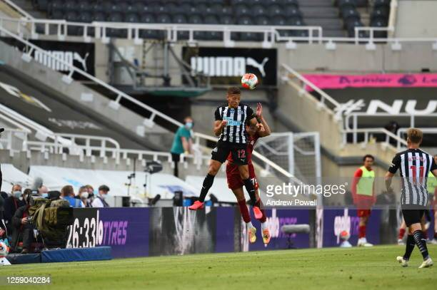 Neco Williams of Liverpool with Dwight Gayle during the Premier League match between Newcastle United and Liverpool FC at St James Park on July 26...
