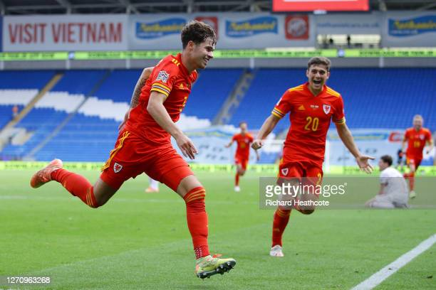 Neco Williams of Wales celebrates with teammate Daniel James after scoring his team's first goal during the UEFA Nations League group stage match...