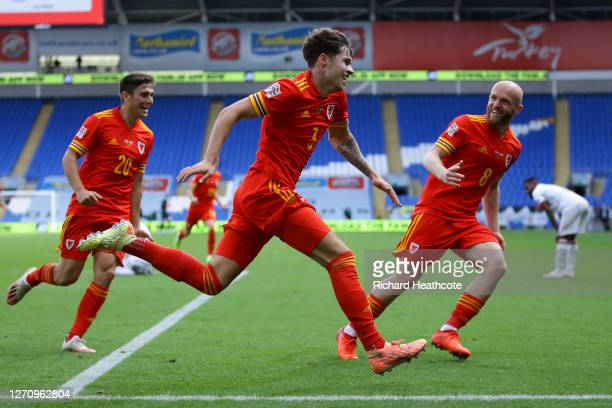 Neco Williams of Wales celebrates with teammates Daniel James and Jonny Williams after scoring his team's first goal during the UEFA Nations League...