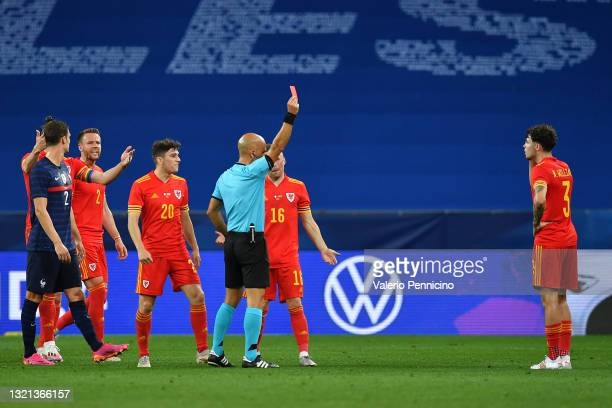 Neco Williams of Wales is shown a Red Card by Match Referee Luis Godinho during the international friendly match between France and Wales at Allianz...