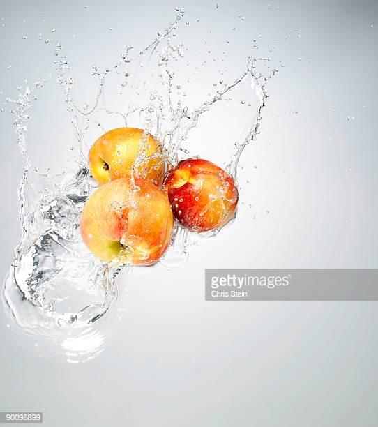 Nectarine splashing in to water