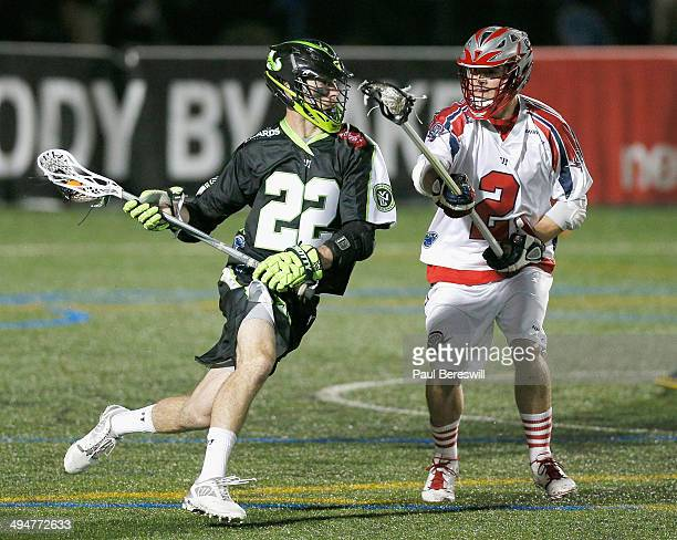 Ned Crotty of the New York Lizards moves around Scott Ratliff of the Boston Cannons to shoot on net in the second half of a Major League Lacrosse...