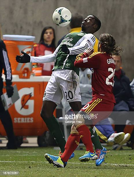 Ned Grabavoy of Real Salt Lake defends Jose Adolfo Valencia of the Portland Timbers during the second half of the Western Conference Championship MLS...