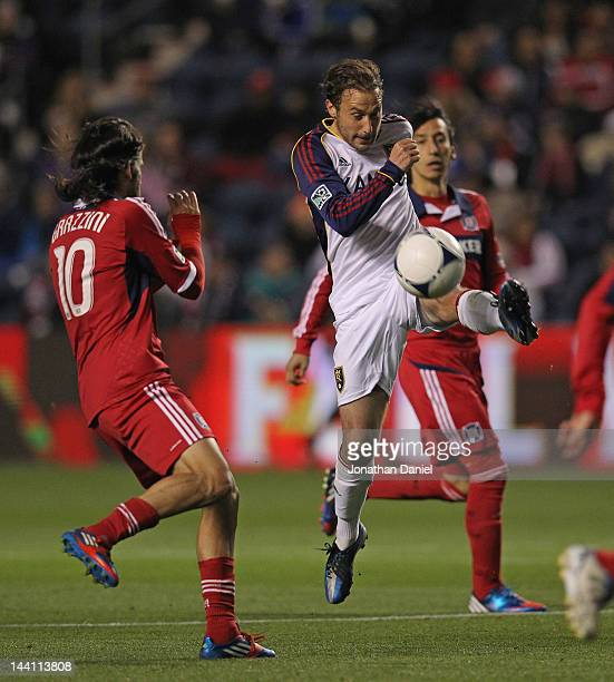Ned Grabavoy of Real Salt Lake passes the ball around Sebastian Grazzini of the Chicago Fire during an MLS match at Toyota Park on May 9 2012 in...