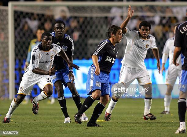 Ned Grabavoy of the San Jose Earthquakes plays the ball at midfield as Brandon McDonald of the Los Angeles Galaxy pursues the play in the second half...