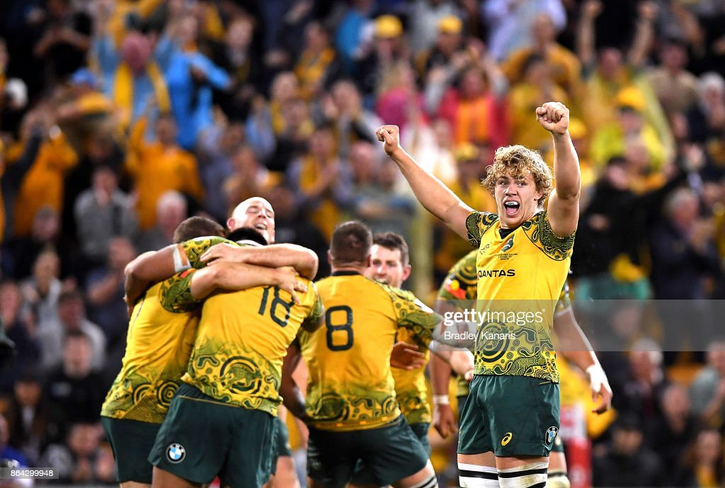 Ned Hanigan and Stephen Moore of the Wallabies celebrate victory with team mates after the Bledisloe Cup match between the Australian Wallabies and the New Zealand All Blacks at Suncorp Stadium on October 21, 2017 in Brisbane, Australia.