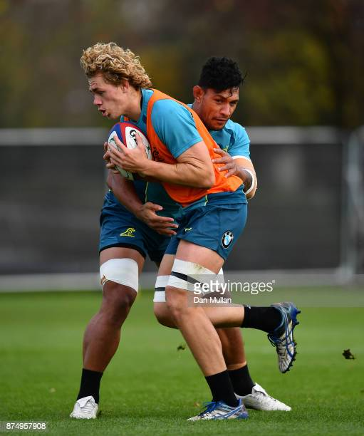 Ned Hanigan of Australia is tackled by Lopeti Timani of Australia during a training session at the Lensbury Hotel on November 16 2017 in London...