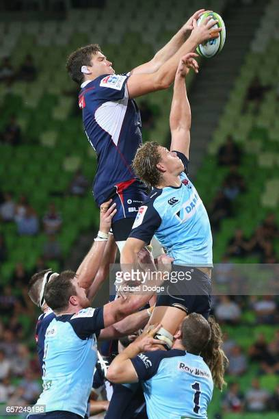 Ned Hanigan of the Waratahs tries to intercept Calum Retallick of the Rebels during the round five Super Rugby match between the Rebels and the...