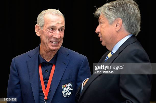 Ned Jarrett talks with Mike Joy during the Hall of Fame Selection at NASCAR Hall of Fame on May 22 2013 in Charlotte North Carolina