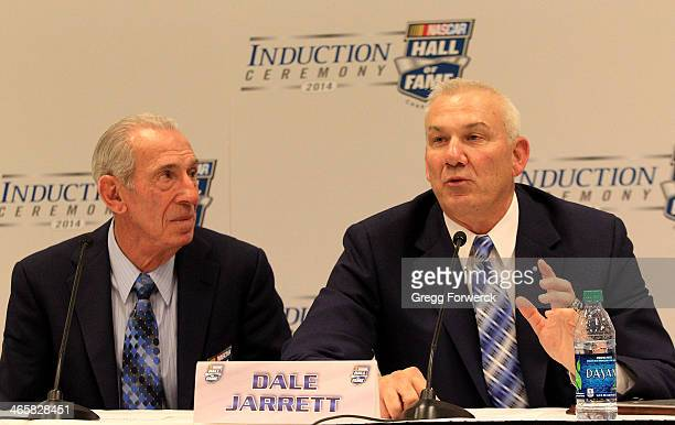Ned Jarrett watches as son Dale Jarrett makes comments to the media following his induction into the NASCAR Hall of Fame on January 29 2014 in...