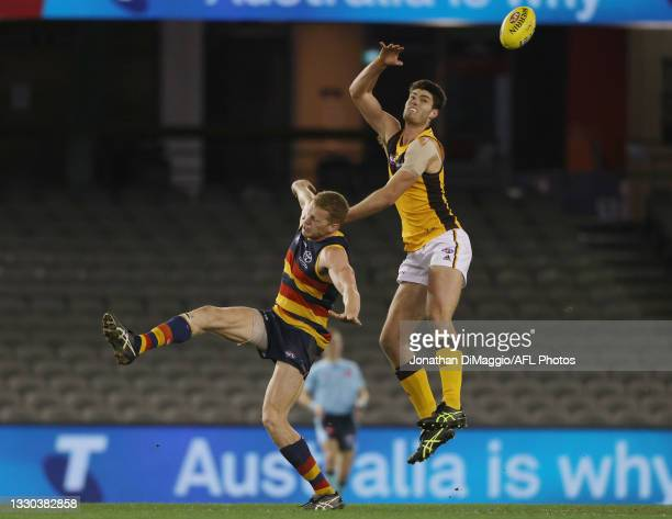 Ned Reeves of the Hawks wins a tap out during the round 20 AFL match between Adelaide Crows and Hawthorn Hawks at Marvel Stadium on July 24, 2021 in...
