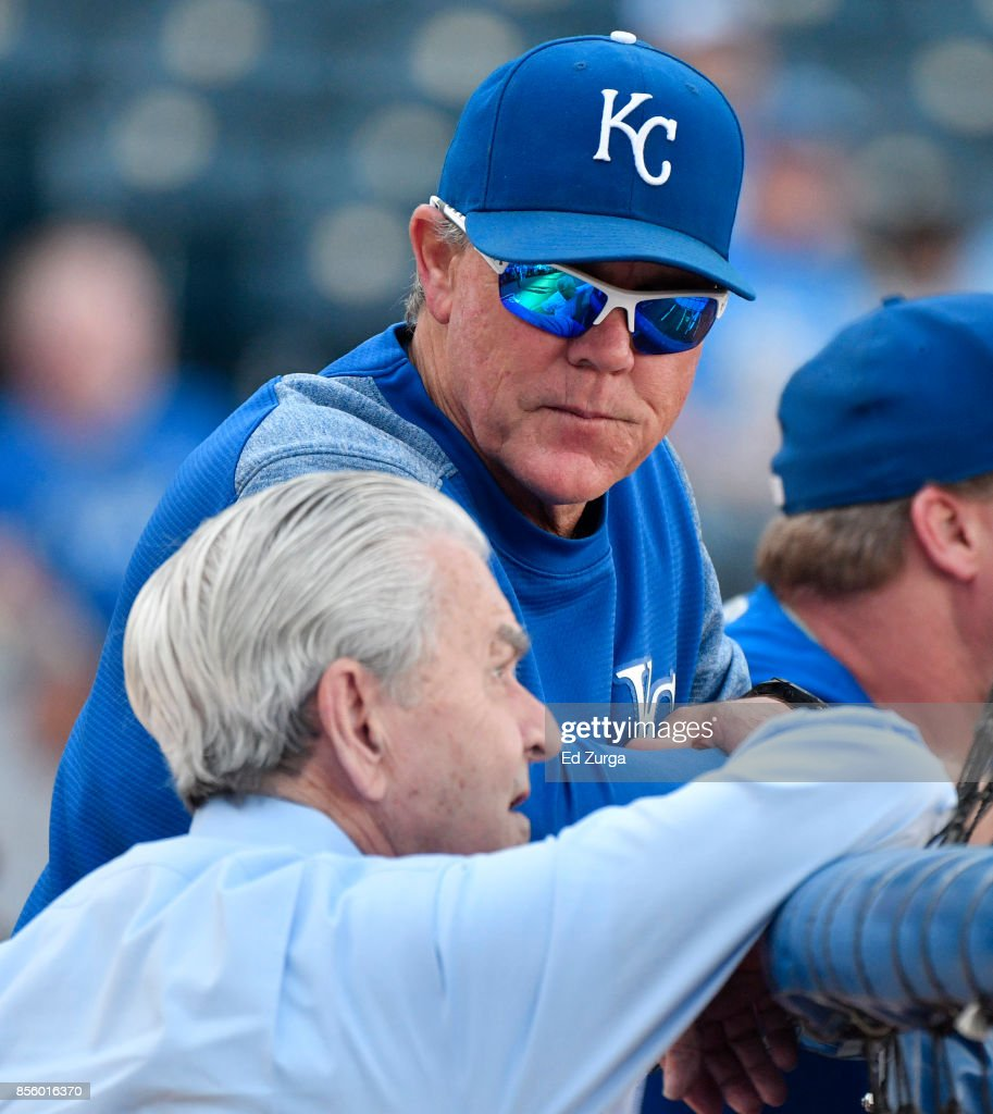 Ned Yost #3 manager of the Kansas City Royals talks with owner David Glass during batting practice prior to a game against the Arizona Diamondbacks at Kauffman Stadium on September 30, 2017 in Kansas City, Missouri.