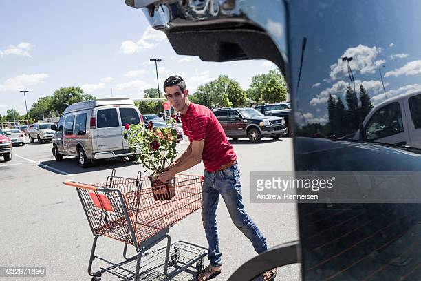 Nedal Al Hayek helps pick out plants at Home Depot for a local landscaping job on July 30 2015 in Bloomfield Hills Michigan Nedal spent three years...