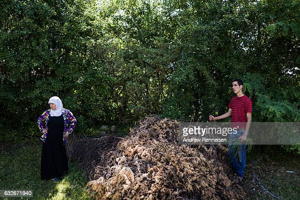 Nedal Al Hayek talks with the owner of the house he is landscaping for on July 30 2015 in Bloomfield Michigan Nedal spent three years studying to be...