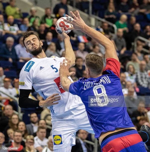 Nedim Remili of France In action with Egor Evdokimov of Russia during the 26th IHF Men's World Championship group A match between France and Russia...