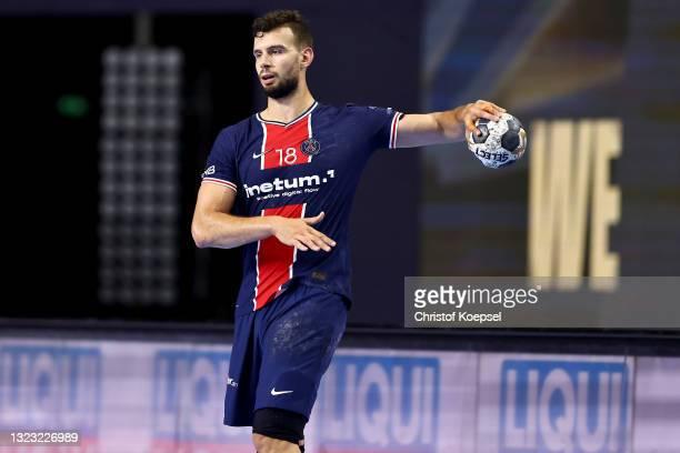 Nedim Remili of Paris Saint-Germain passes the ball during the VELUX EHF Champions League FINAL4 semi-final between Aalborg Handbold v Paris...