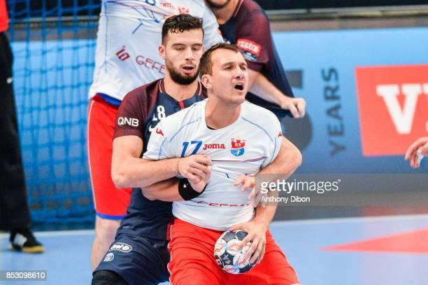 Nedim Remili of PSG and Dzimtry Nikulenkau of Brest Meshkov during champions League match between Paris SaintGermain and Brest on September 24 2017...
