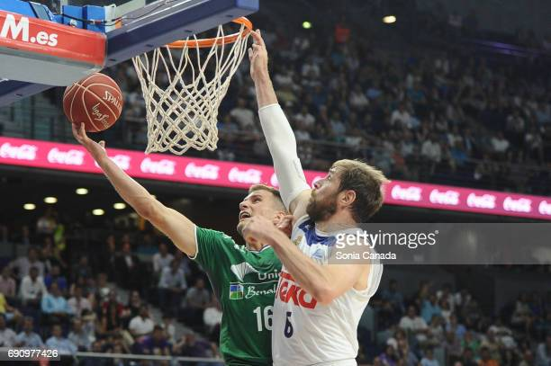 Nedovic #16 forward of Unicaja and Andres 'Chapu' Nocioni #6 forward of Real Madrid during the Liga Endesa Semi Final game between Real Madrid and...