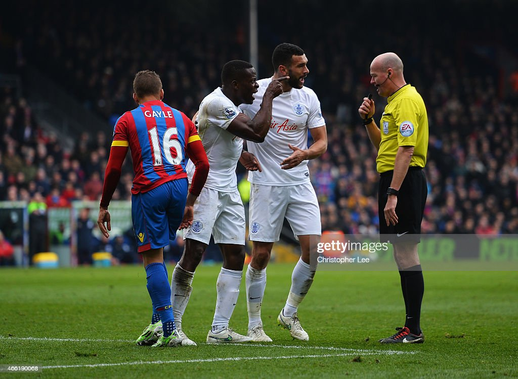 Nedum Onuoha and Steven Caulker of QPR confront referee Lee Mason during the Barclays Premier League match between Crystal Palace and Queens Park Rangers at Selhurst Park on March 14, 2015 in London, England.
