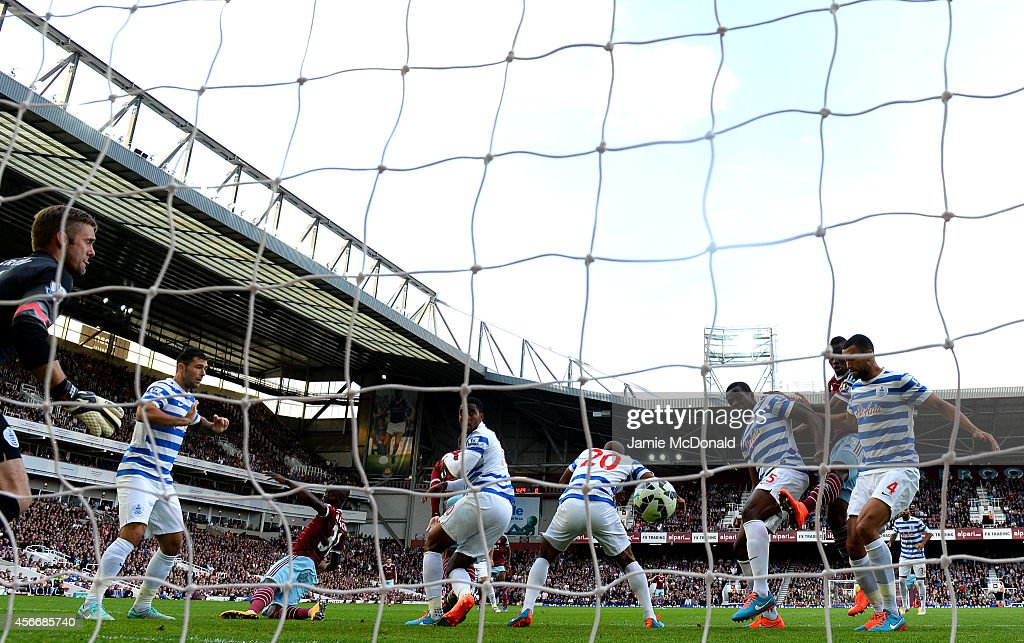 Nedum Onuoha of QPR scores an own goal during the Barclays Premier League match between West Ham United and Queens Park Rangers at Boleyn Ground on October 5, 2014 in London, England.