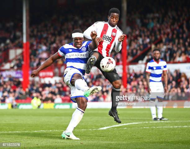 Nedum Onuoha of Queens Park Rangers and Florian Jozefzoon of Brentford challenge for the ball during the Sky Bet Championship match between Brentford...