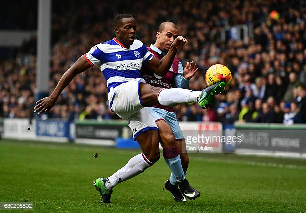 Nedum Onuoha of Queens Park Rangers battles for the ball with Gabriel Agbonlahor of Aston Villa during the Sky Bet Championship match between Queens...