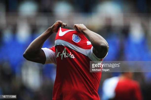 Nedum Onuoha of Queens Park Rangers pulls his jersey over his head after his team was relegated during the Barclays Premier League match between...