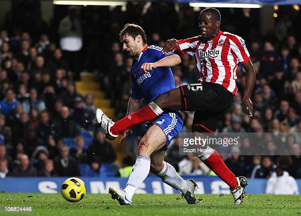 Nedum Onuoha of Sunderland beats Branislav Ivanovic of Chelsea to score their first goal during the Barclays Premier League match between Chelsea and...