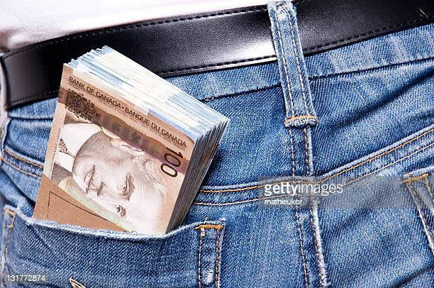 need some cash? - canadian currency stock pictures, royalty-free photos & images