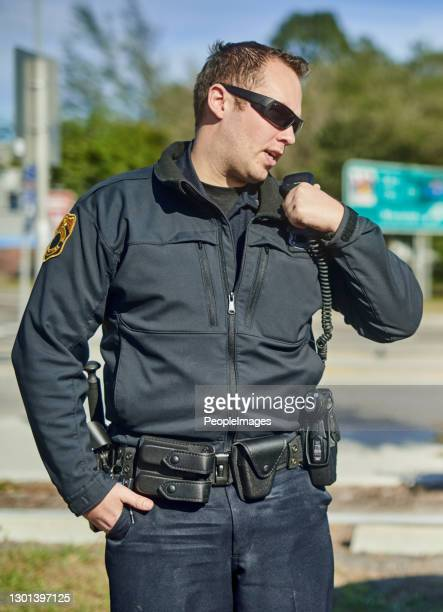 i need you to run these plates... - traffic police officer stock pictures, royalty-free photos & images