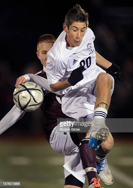Needham's Brandon Miskin, #20, gets the inside position on Amherst's Jesse Welborn, #6, in the Boys Division 1 State Soccer Championship game at...