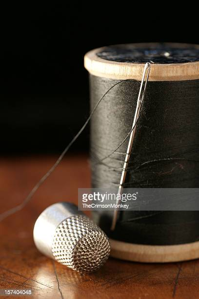 needle and thread sewing kit - thimble stock photos and pictures