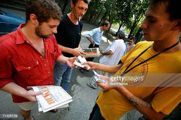 A needle exchange volunteer gives needles to a addict on August 19 2005 in Odessa Ukraine A needle exchange programme run in Odessa by a local NGO...