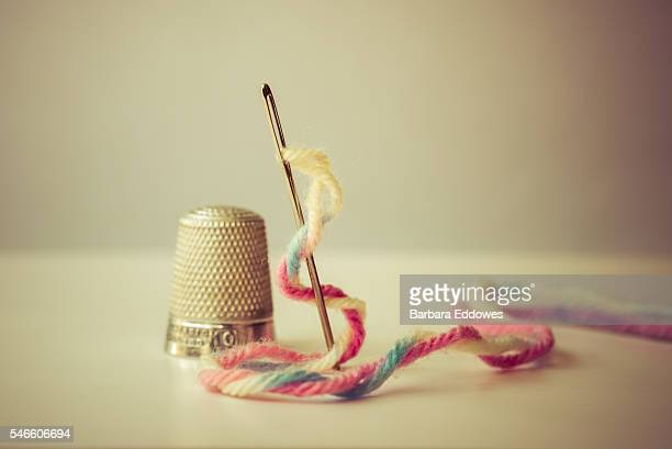 needle, wool & thimble - thimble stock photos and pictures
