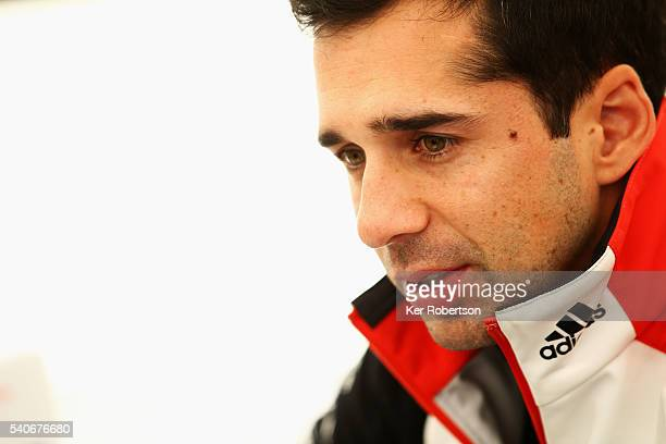 Neel Jani of Switzerland and Porsche Team is interviewed at a media session prior to qualifying for the Le Mans 24 Hour race at the Circuit de la...
