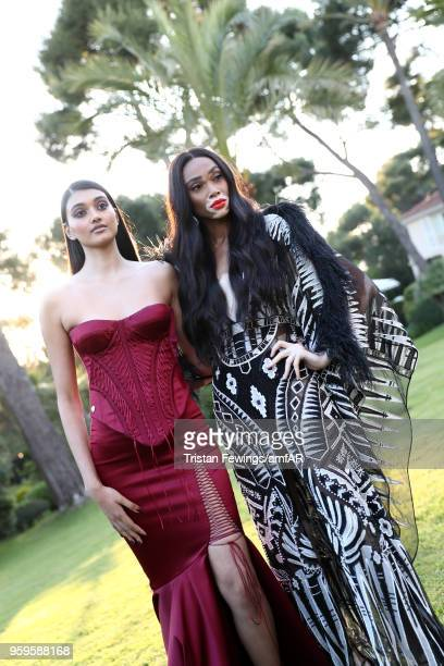 Neelam Gill and Winnie Harlow attend the cocktail at the amfAR Gala Cannes 2018 at Hotel du CapEdenRoc on May 17 2018 in Cap d'Antibes France