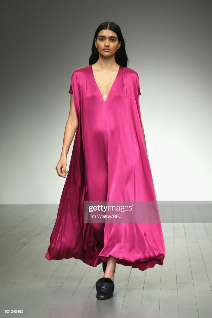 Neelam Gill walks the runway at the Teatum Jones show during London Fashion Week February 2018 at BFC Show Space on February 20, 2018 in London, England.