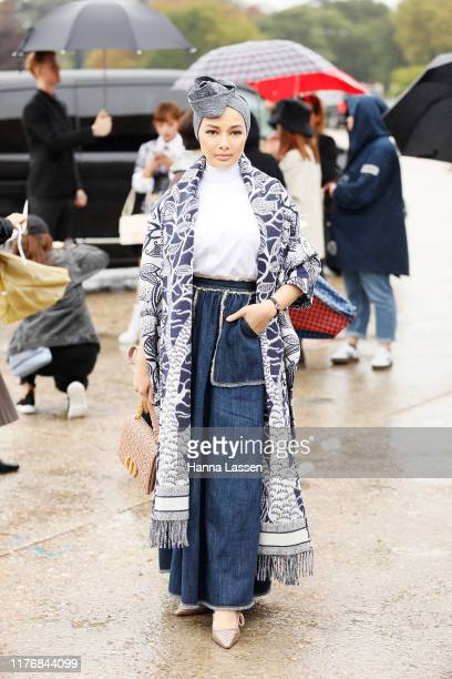 Neelofa Mohd Noor wearing oversized Dior scarf and clutch on September 24 2019 in Paris France