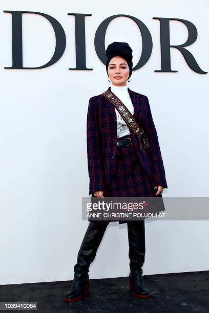 Neelofa Noor poses during the photocall prior to the Christian Dior's SpringSummer 2019 ReadytoWear collection fashion show in Paris on September 24...