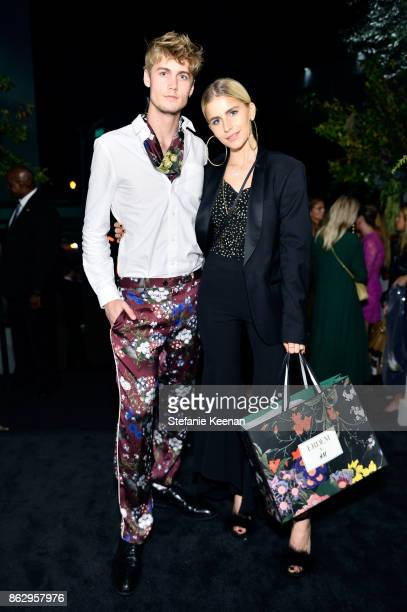 Neels Visser and Caroline Daur at HM x ERDEM Runway Show Party at The Ebell Club of Los Angeles on October 18 2017 in Los Angeles California