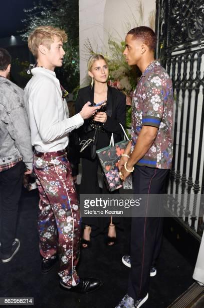 Neels Visser Caroline Daur and Cordell Broadus at HM x ERDEM Runway Show Party at The Ebell Club of Los Angeles on October 18 2017 in Los Angeles...